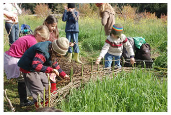 Kids working in LEF's demonstration garden