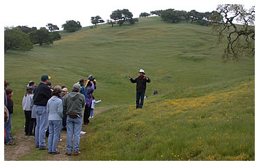 Joe Morris explains his holistic management practices to a group in 2005