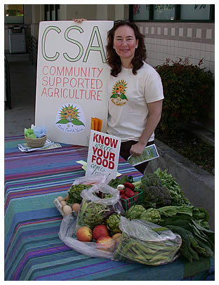 "Mary at the LEF table on ""Earth Day on the Avenue"" in Willow Glen"