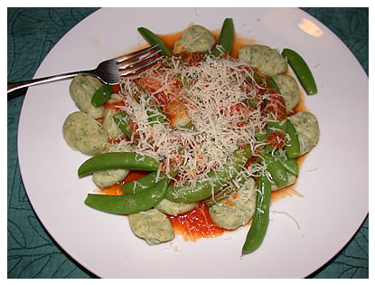 Ricotta-dill gnocchi with sugar snap peas and garlic-lemon-butter-tomato sauce